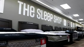 Motion of display new beds. Inside Sears store stock footage