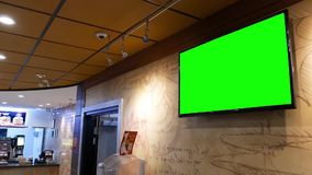 Motion of display tv with green screen. Inside restaurant on wall stock video footage