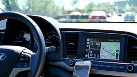 Motion of driver with GPS navigation on dashboard