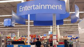 Motion of entertainment sign on top and people looking for buying tv stock video footage
