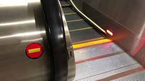 Motion of escalator moving and wrong direction sign inside shopping mall. In Taiwan stock footage