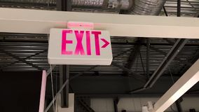 Motion of exit sign stock video footage