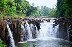 Motion and flowing water of Tad Pha Suam waterfall Royalty Free Stock Photo