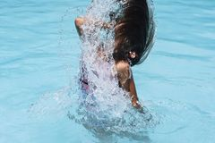 Motion freeze on a girl splashing the sea water with her hair.Motion freeze royalty free stock photography