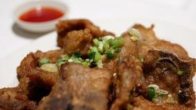 Motion of fried pork inside restaurant stock footage