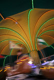 Motion fun. On a lighted carousel in a tent Stock Photos