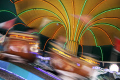 Motion fun. On a lighted carousel in a tent Royalty Free Stock Photos
