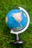 Motion globe. In green grass Stock Photo