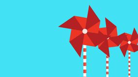 Motion graphic of a red pinwheel that is moved by the wind stock video footage