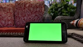 Motion of green screen phone in front of display sofa. Inside the Canadian tire store stock video