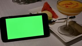 Motion of green screen phone and mango pudding dessert. Inside Shang Palace restaurant stock video footage