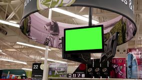 Motion of green screen tv on display sport equipment for sale section stock video footage