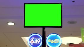Motion of green screen tv at lottery centre stock video footage