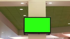 Motion of green screen tv for your ad on wall at food court area. Inside Coquitlam shopping mall stock video footage