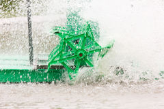 Motion of green water turbine spin. Stock Image