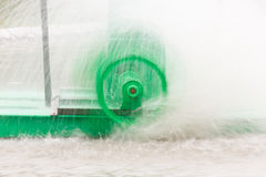 Motion of green water turbine spin. Royalty Free Stock Photos