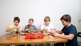 Creative kids using building kit.