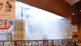 Motion of heavy steam soup dumpling inside bamboo steamer basket. In Taiwan stock video footage