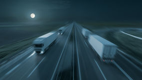Motion image of modern delivery trucks on the highway at night