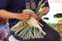 The villagers took bamboo stripes to weave into different forms for daily use. Motion image - The villagers took bamboo stripes to weave into different forms for Royalty Free Stock Image