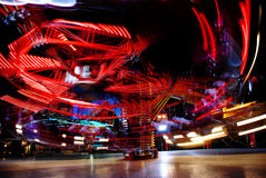 Motion of lights. Terrific speed of carousel in evening park Stock Image