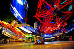 Motion of lights. Terrific speed of carousel in evening park Stock Images