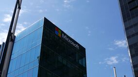 Motion of Microsoft corporate building against blue sky