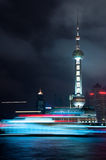 Motion Moving boat with Oriental Pearl Tower. Motion of boat moving on the river with Oriental pearl tower background Great night scene at the Bund Shanghai Royalty Free Stock Photo
