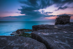 Motion moving clound at sunset at rocky cliffs Stock Image
