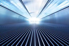 Motion of moving modern escalator Royalty Free Stock Photography