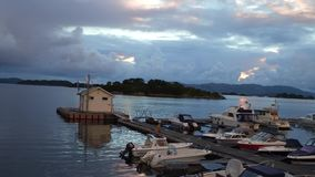 Motion over boats at pier shed on platform to island in bay stock footage