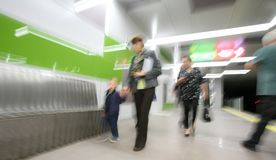 Motion Passage Metro Station. Motion blurred image of a modern metro station with unrecognizable commuters Royalty Free Stock Image