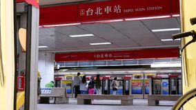 Motion of passenger getting on and off the MRT while it stopping on the platform. In Taipei Taiwan stock video footage