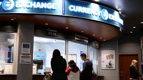 Motion of passengers at foreign currency exchange place inside YVR airport stock footage