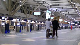 Motion of passengers with luggage at departure area stock video