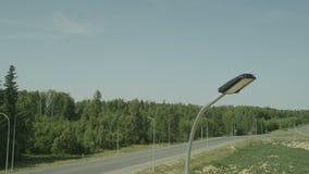 Motion past high led street light at empty crossroad. KAZAN, TATARSTAN/RUSSIA - APRIL 28 2014: Motion past high modern powerful nice LED street light at empty stock video footage