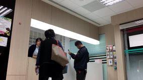 Motion of patient register their name at service counter. At the health center stock footage