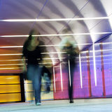 Motion people. Multi colored underground tunnel with people in morion Royalty Free Stock Images