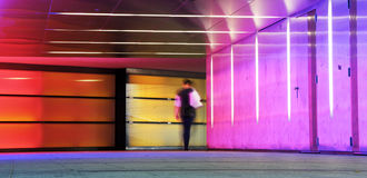 Motion people. Multi colored underground tunnel with people in morion Stock Photo