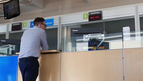 Motion of people applying driver license at reception site stock video footage