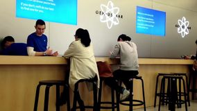 Motion of people browsing new iphone stock video