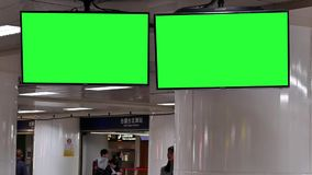 Motion of people busying to take train at night with green screen traffic board. Inside Taipei main station stock video footage