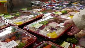 Motion of people buying bbq bento. Inside T&T supermarket stock video footage