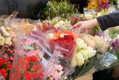 Motion of of people buying flower inside price smart foods store Stock Photos