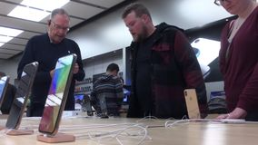 Motion of people buying iphone and paying credit card. Inside Apple store