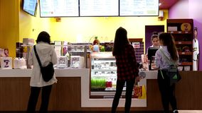 Motion of people buying juice at Booster Juice shop stock video