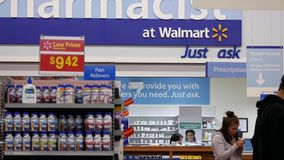 Motion of people buying medicine at pharmacy section stock video footage