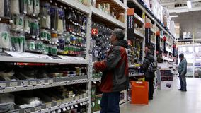 Motion of people buying multimedia networking and home electronics product. In Home Depot store stock video footage