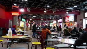 Motion of people enjoying meal at food court area stock video footage
