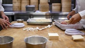 Motion of people are kneading the dough and shaping it with their hands to make dumplings stock video footage